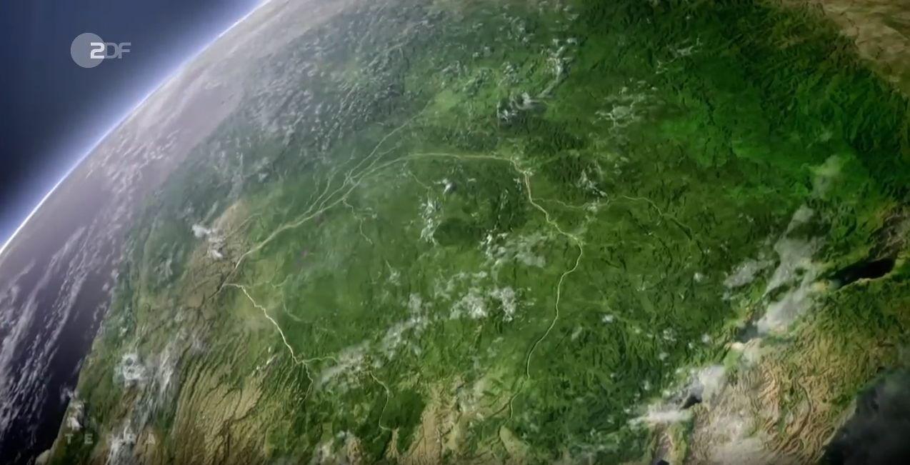 Aufnahme unserer Erde aus dem Weltall - grüne Erdkugel, linke Seit mit blauem Wasser und vielen Flüssen