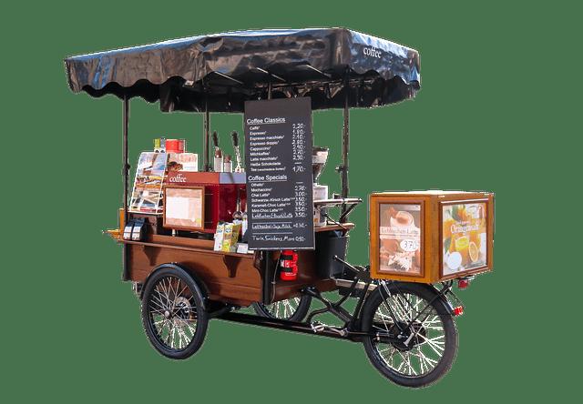 schwarzes langezogenes Lastenrad vorderer Ladekiste und Dach